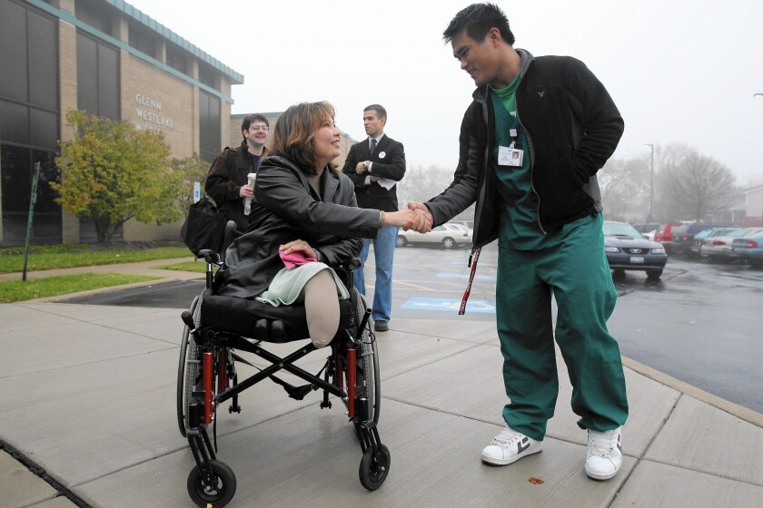 Rep. Tammy Duckworth (D-Ill.), shown on the campaign trail in 2006, recently upbraided a government contractor, accusing him of gaming the veterans disability system. Duckworth, an Army veteran, lost both legs in Iraq in 2004 when her helicopter was shot down.