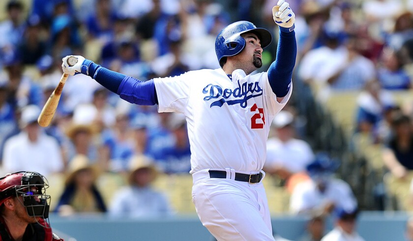 Dodgers first baseman Adrian Gonzalez hits a home run against Arizona in September.