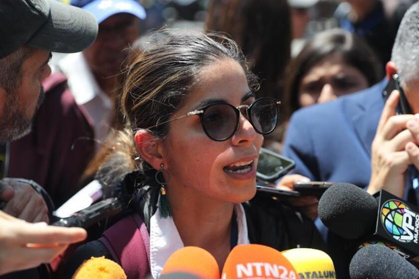 Mauren Barriga, a journalist with Spanish international news agency EFE, speaks to reporters press after being released, in Caracas, Venezuela, on Jan. 31, 2019. EPA-EFE/MIGUEL GUTIERREZ