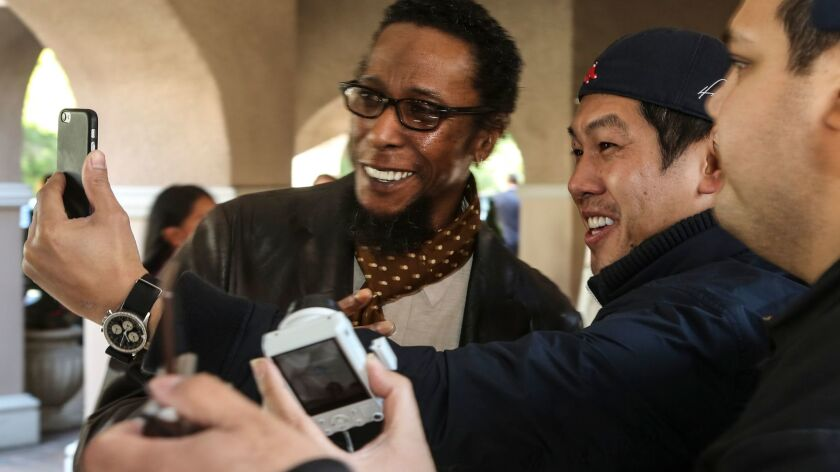 "Actor Ron Cephas Jones from NBC's ""This Is Us,"" signs autographs and poses for pictures."