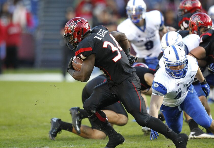 Aztecs running back Walter Kazee churns out the yards in the 2nd half during SDSU's football game against Air Force Saturday afternoon at Qualcomm Stadium.
