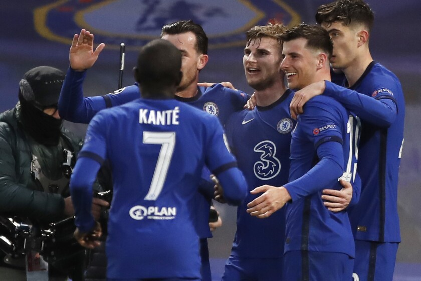 Chelsea's Timo Werner, third from right, celebrates with his teammates after scoring his side's first goal during the Champions League semifinal 2nd leg soccer match between Chelsea and Real Madrid at Stamford Bridge in London, Wednesday, May 5, 2021. (AP Photo/Alastair Grant)
