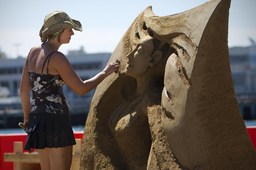 At the U.S. Sand Sculpting Challenge in San Diego, Helena Bangert from Netherlands works on the small details in her art piece.