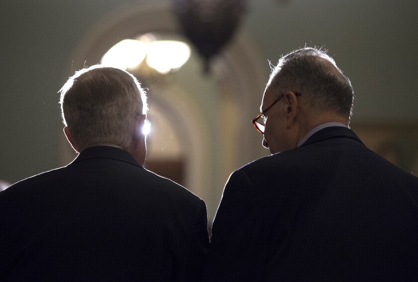 Senate Minority Leader Harry Reid (D-Nev.), left, and successor Sen. Charles E. Schumer (D-N.Y.) in Washington as Reid's last session wraps up.