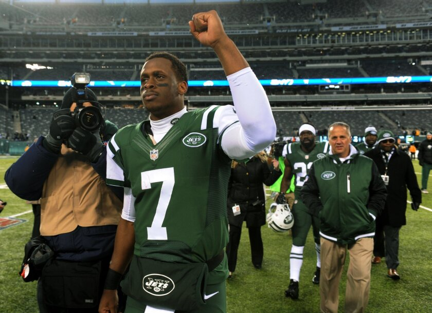 New York Jets quarterback Geno Smith gestures while walking off the field at the end of an NFL football game against the Oakland Raiders, Sunday, Dec. 8, 2013, in East Rutherford, N.J. The Jets won 37-27. (AP Photo/Bill Kostroun)