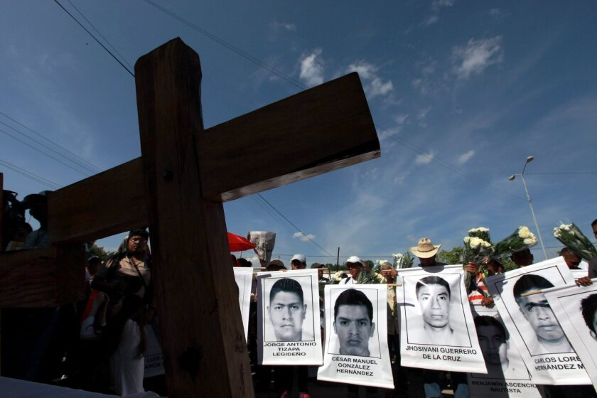 RELATIVES OF 43 students missing in Mexico since September and believed slain attend a Mass for them in Iguala.
