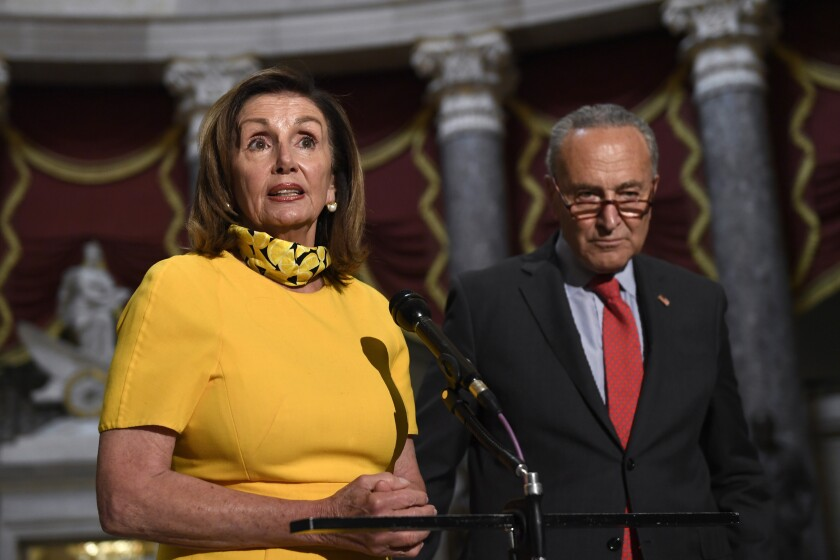 House Speaker Nancy Pelosi of Calif., left, speaks as she stands next to Senate Minority Leader Sen. Chuck Schumer of N.Y., right, on Capitol Hill in Washington, Monday, Aug. 3, 2020. Schumer and Pelosi met earlier with Treasury Secretary Steven Mnuchin and White House Chief of Staff Mark Meadows as they continue to negotiate a coronavirus relief package. (AP Photo/Susan Walsh)