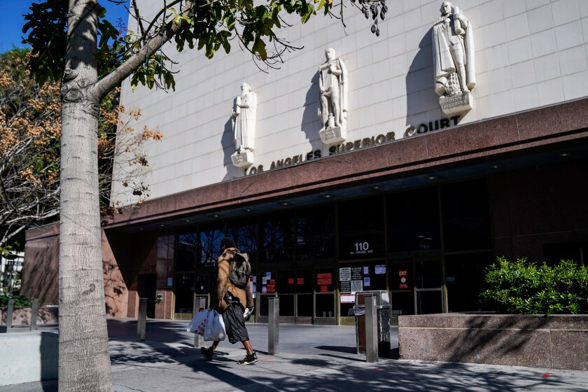 The Stanley Mosk Superior Court in downtown Los Angeles on Saturday. Earlier in the week, California Gov. Gavin Newsom issued a stay-at-home order to the state to help slow the spread of the coronavirus outbreak.