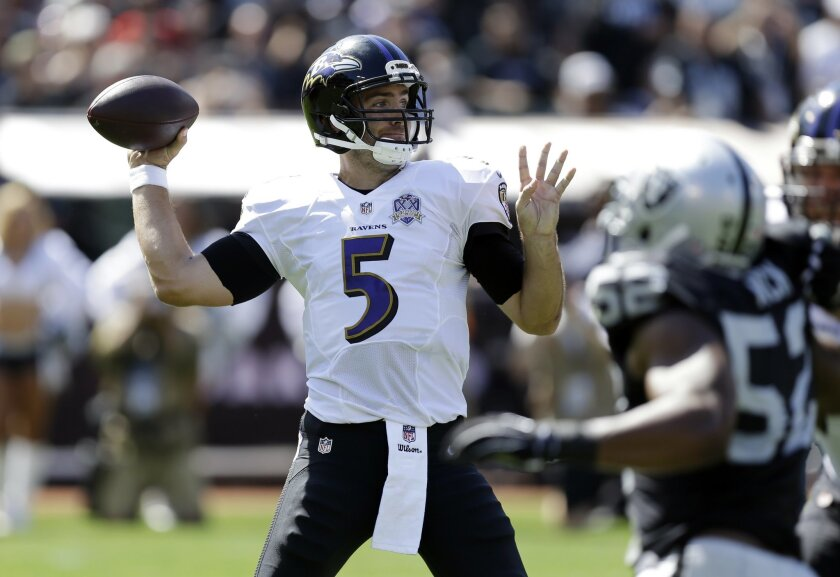 Baltimore Ravens quarterback Joe Flacco (5) throws against the Oakland Raiders during the first half of an NFL football game Sunday, Sept. 20, 2015, in Oakland, Calif. (AP Photo/Ben Margot)