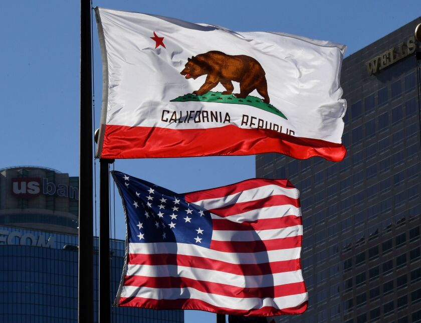 A campaign for California to secede from the U.S. is gaining support after Donald Trump's election as president. Above, the California and U.S. flags fly in downtown Los Angeles.