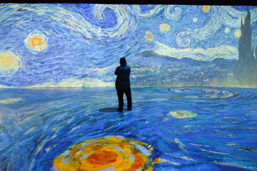"A spectator in ""Beyond Van Gogh,"" which opens at the Del Mar Fairgrounds in January 2022."