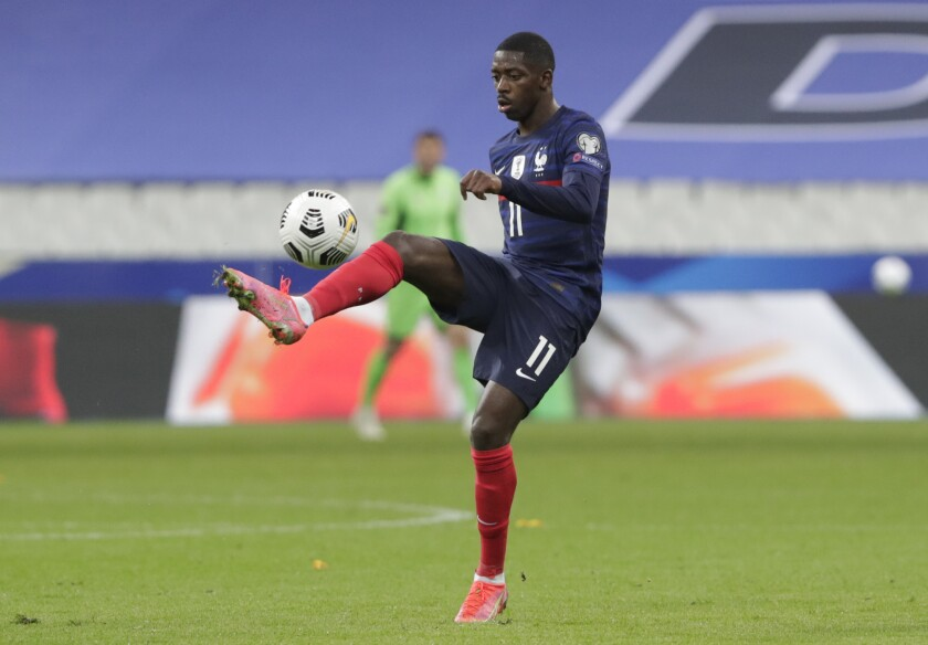 FILE - In this file photo dated Wednesday, March 24, 2021, France's Ousmane Dembele controls the ball during the World Cup 2022 soccer match against Ukraine at the Start de de France stadium, in Saint Denis, north of Paris. At first criticized for not fitting into Barcelona's passing style, Dembele is now credited with diversifying Barcelona's attack with his solo efforts and unbridled confidence to shoot from long range.(AP Photo/Thibault Camus, FILE)