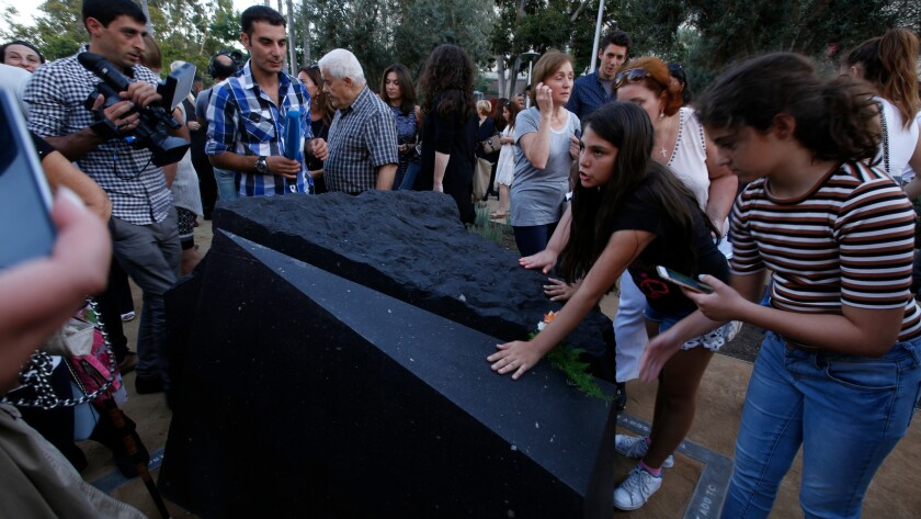 Melani Nazarian, left, and Ashley Muradian view the first permanent monument in L.A. to memorialize the Armenian genocide after it was unveiled at Grand Park.