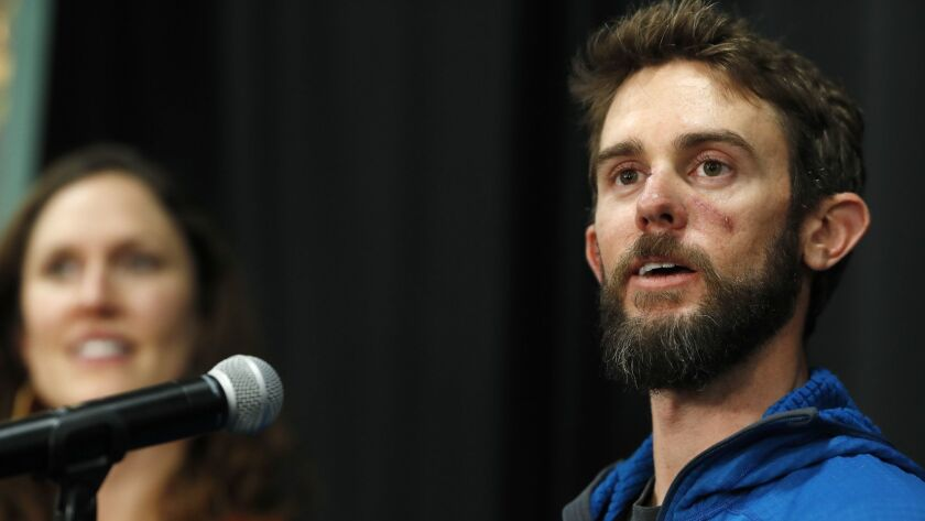 Travis Kauffman responds to questions during a Feb. 14 news conference in Fort Collins, Colo. Kaufman's girlfriend, Annie Bierbower, looks on at left.