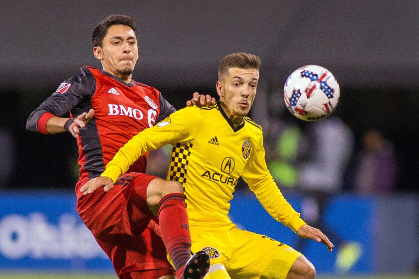 Nov 21, 2017; Columbus, OH, USA; Toronto FC midfielder Marky Delgado (18) and Columbus Crew SC forward Pedro Santos (32) fight for possession of the ball in the second half of the game in the first leg of the MLS Eastern Conference Championship at MAPFRE Stadium.