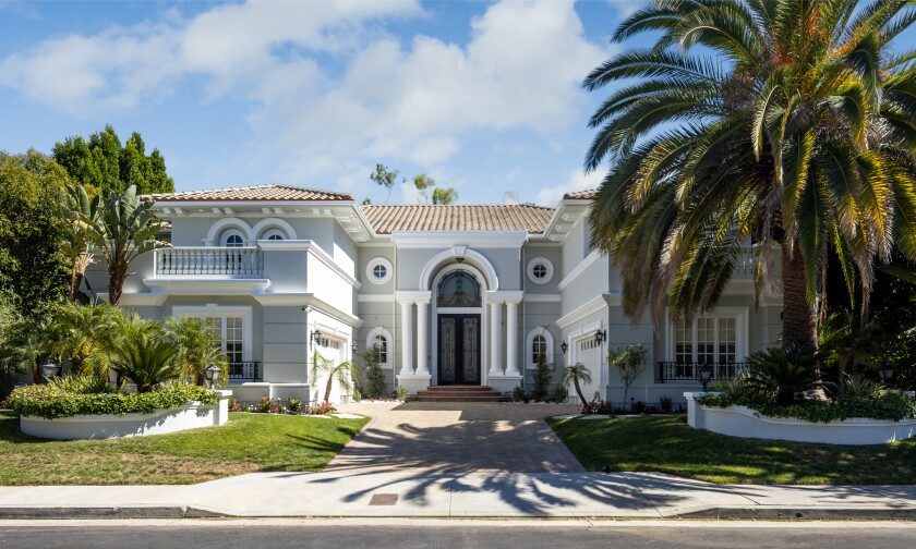 Built in 2000, the two-story home in Mulholland Park has seven bedrooms, seven bathrooms, a dramatic foyer with dual staircases and a two-story living room with a floor-to-ceiling fireplace.