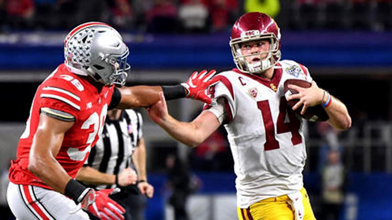 USC quarterback Sam Darnold tries to scramble away from Ohio State linebacker Malik Harrison late in the fourth quarter.
