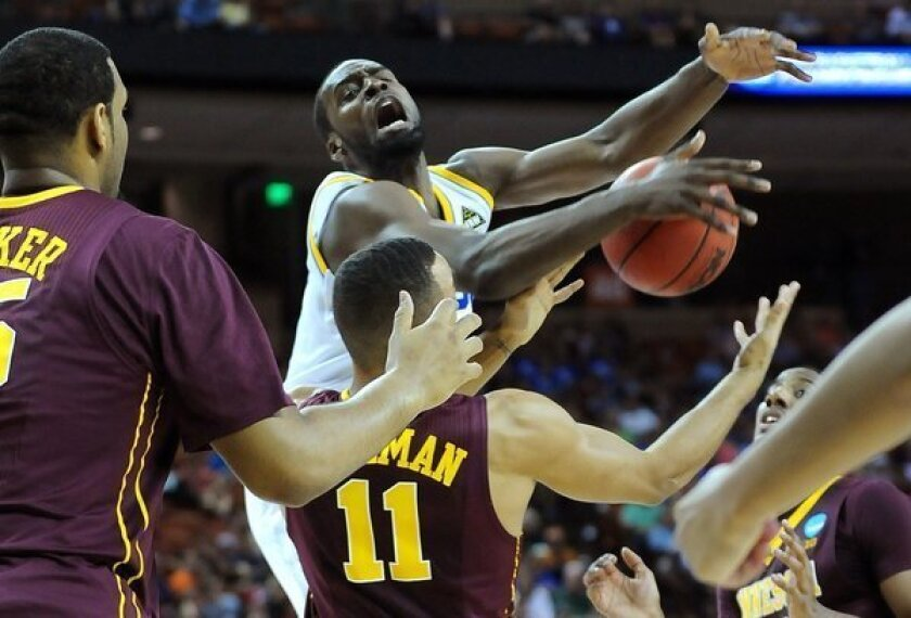 UCLA guard Shabazz Muhammad is fouled by Minnesota guard Joe Coleman on a drive to the basket in the first half Friday night.