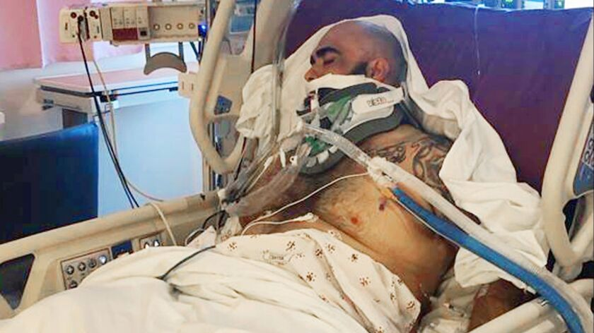 This undated photo provided by the Reyna family shows Rafael Reyna in his hospital bed at Los Angele