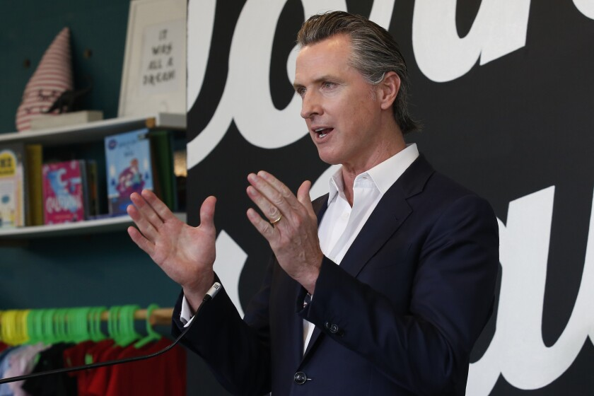 On May 5, Gov. Gavin Newsom discusses his plan for the gradual reopening of California businesses during a news conference.