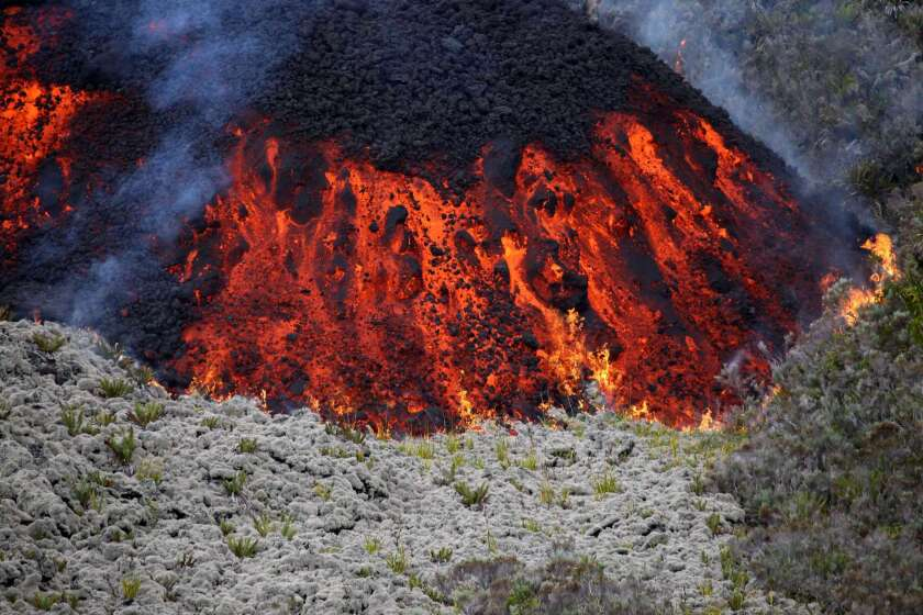 Lava flows out of the Piton de la Fournaise volcano as it erupts on Friday on Reunion Island in the Indian Ocean.
