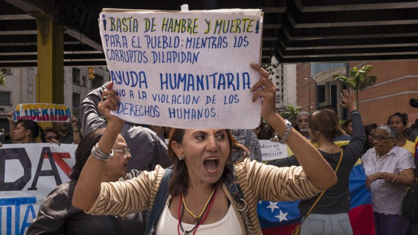 People gather in Caracas to support opposition leader Juan Guaido's request to the Venezuelan military of backing him in a transitional government. January 30, 2019. (Adriana Loureiro Fernandez / For The Times)