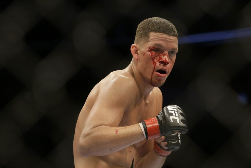 Nate Diaz fights Josh Thomson in a UFC lightweight mixed martial arts fight in San Jose, Calif., Saturday, April 20, 2013. Thomson won by technical knock out in the second round. (AP Photo/Jeff Chiu)