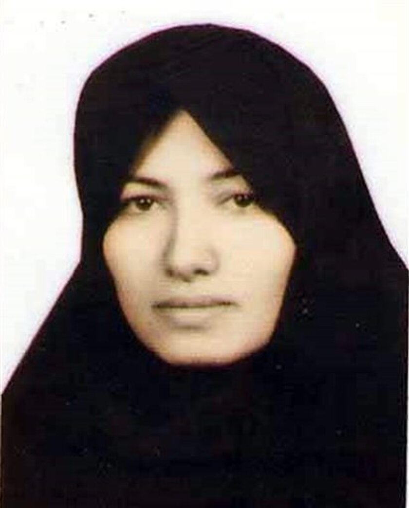 FILE - This undated file image made available by Amnesty International in London on Thursday July 8, 2010, of Sakineh Mohammadi Ashtiani, a mother of two who is facing the punishment of stoning to death in Iran, on charges of adultery. Iran said Monday, Oct. 11, 2010, that it had arrested two foreigners as they were interviewing the son of a woman whose sentence of death by stoning on an adultery conviction has ignited international outrage. ran's judiciary spokesman Gholam Hossein Mohseni Ejehi said the two foreigners arrested had entered the country on tourist visas and did not have documents to prove they were journalists. His comments were carried on the official IRNA news agency. (AP Photo/Amnesty International, ho, File)