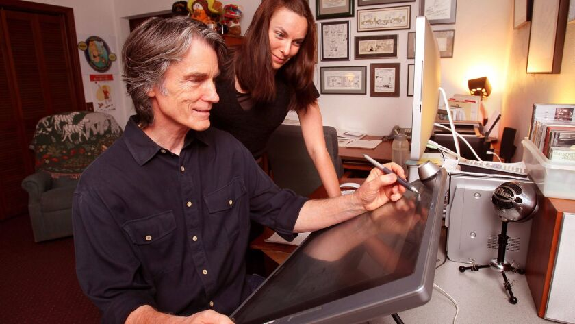 """""""Luann"""" comic strip artist Greg Evans works on a strip with his daughter, Karen Evans, at his San Marcos home in this photo taken in 2013."""