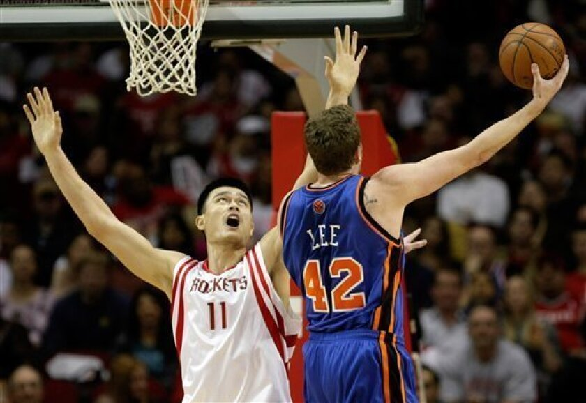 New York Knicks center David Lee (42) shoots over Houston Rockets center Yao Ming (11), of China, in the first quarter of an NBA basketball game on Saturday, Jan. 10, 2009, in Houston. (AP Photo/Bob Levey)