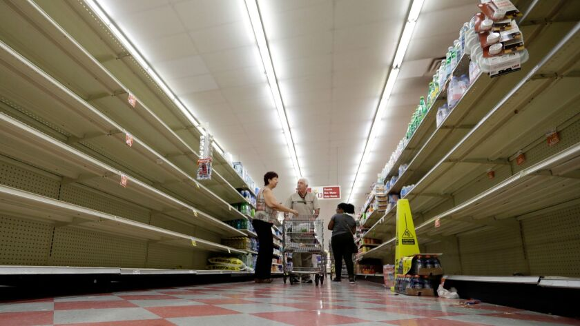The bottled water aisle in a Houston grocery store was nearly empty last week as Hurricane Harvey approached. Would price gouging have kept the shelves filled?