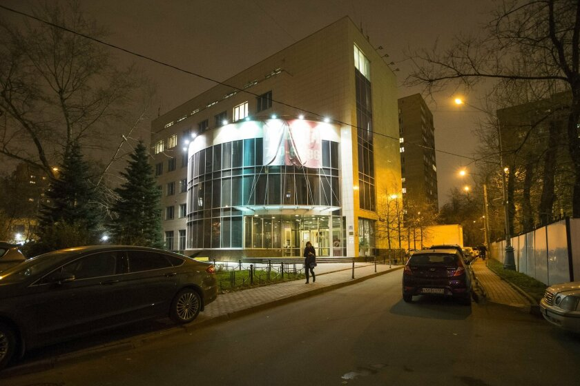 FILE In this November 9, 2015 file photo a woman walks from the entrance of National anti-doping agency, RUSADA in Moscow, Russia. The World Anti-Doping Agency says a deal has been signed Tuesday, Feb. 9, 2016, for British officials to take temporary charge of drug-testing in Russia. The Russian an