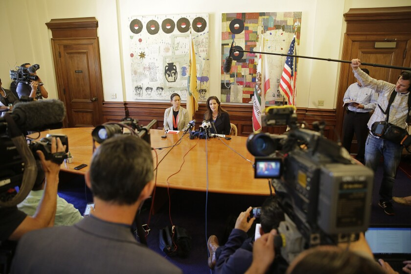 Oakland Mayor Libby Schaaf, right, sits with city administrator Sabrina Landreth during a news conference last week about the city's widening Police Department sex scandal.