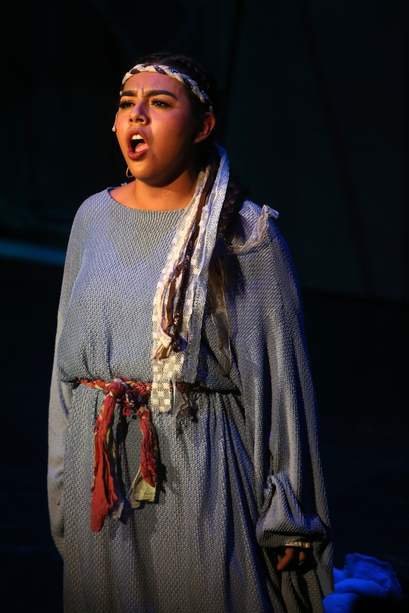 "Estefani Lopez performs during a final dress rehearsal of ""Amahi and the Night Visitors,"" at LA County High School for the Arts"