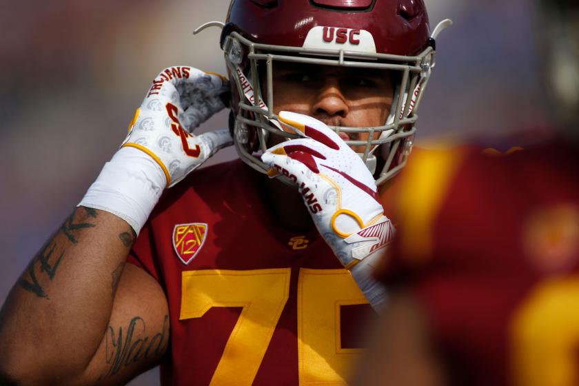 USC guard Alijah Vera-Tucker adjusts his helmet.