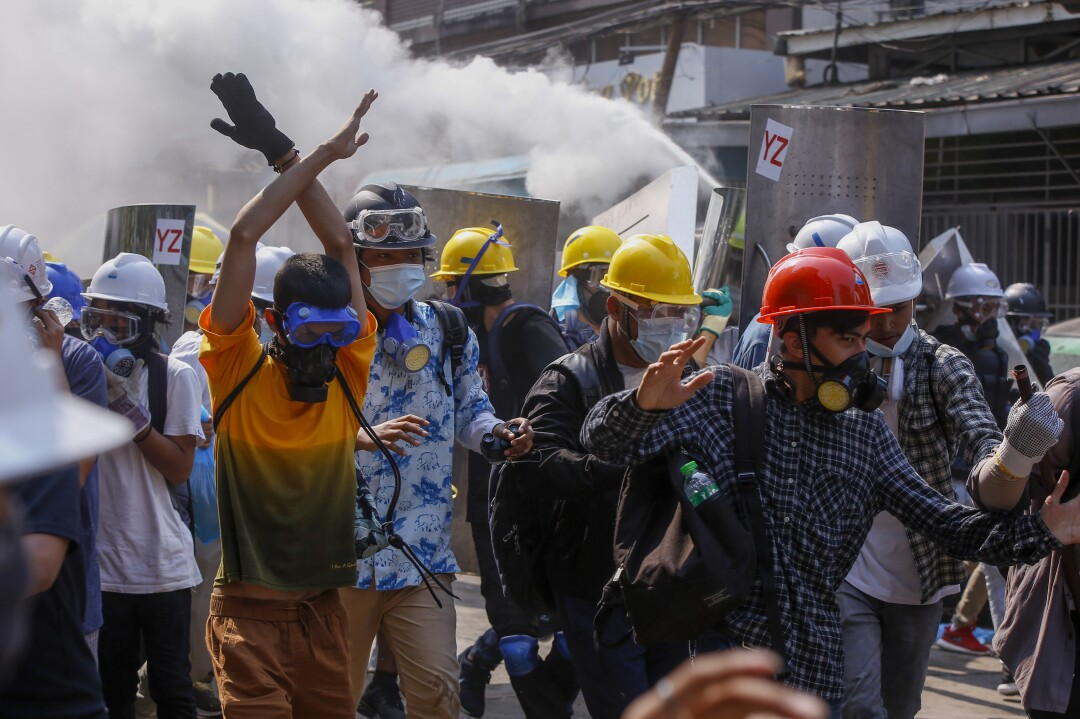 Anti-coup protesters retreat from the front lines