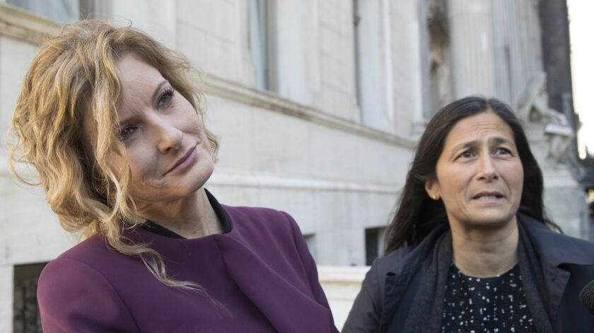 Summer Zervos, left, and her attorney Mariann Wang speak to reporters outside New York state appellate court on Oct. 18.