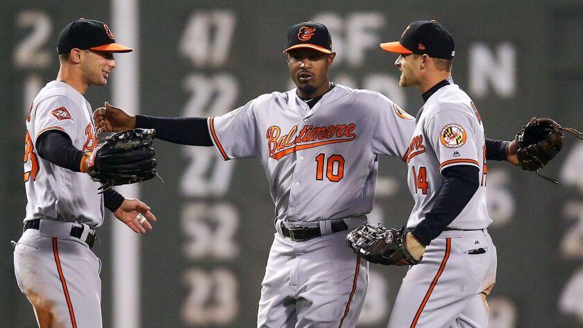 BOSTON, MA - MAY 01: Joey Rickard #23, Adam Jones #10 and Craig Gentry #14 of the Baltimore Orioles