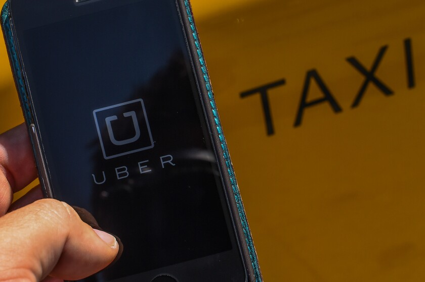 Taxi companies in California are taking legal action against Uber for allegedly misleading customers into thinking they provide a safer service than traditional taxi cabs.