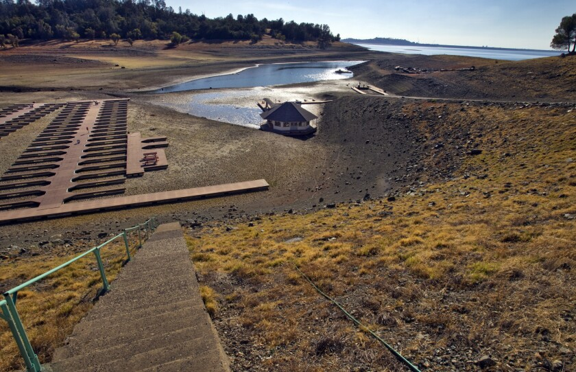 Severe drought conditions reveal over 600 empty docks sitting on dry, cracked dirt at Folsom Lake Marina, which is one of the largest inland marinas in California and is down 35 percent, at Folsom Lake State Recreational Area.