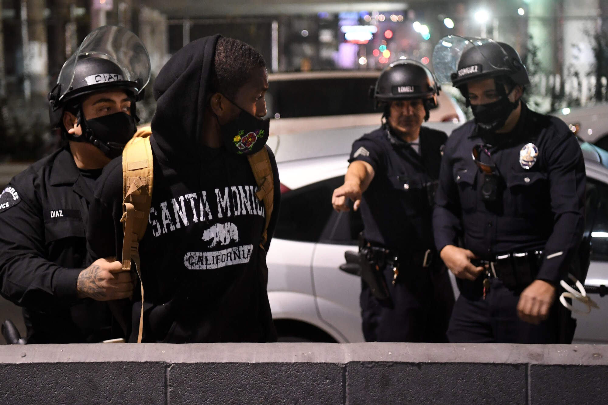 LAPD officers arrest a protester on Figueroa Street in downtown Los Angeles on election night.