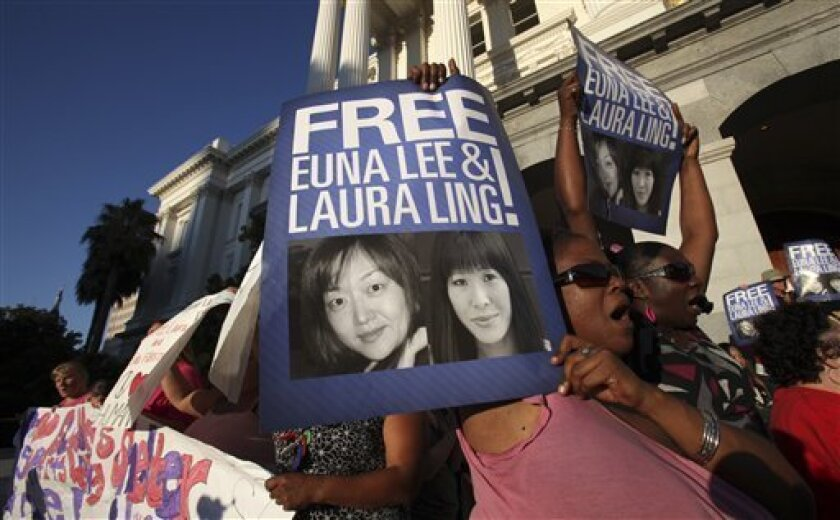 """More than 250 people rallied calling for the release of imprisoned American journalists Laura Ling and Euna Lee at the Capitol in Sacramento, Calif., Thursday, July 9, 2009. The vigil was held for Ling and Lee who were sentenced to 12 years of hard labor by North Korea for entering the country illegally and """"hostile acts."""" (AP Photo/Rich Pedroncelli)"""