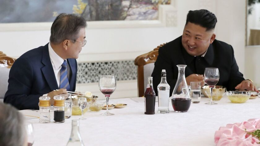 North Korean leader Kim Jong Un (right) and South Korean President Moon Jae-in talk during lunch at the Okryukwan cold noodle restaurant in Pyongyang on Sept. 19, 2018.