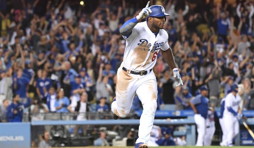 LOS ANGELES, CALIFORNIA AUGUST 16, 2017-Dodgers Yasiel Puig celebrates the game-winning hit as he ro