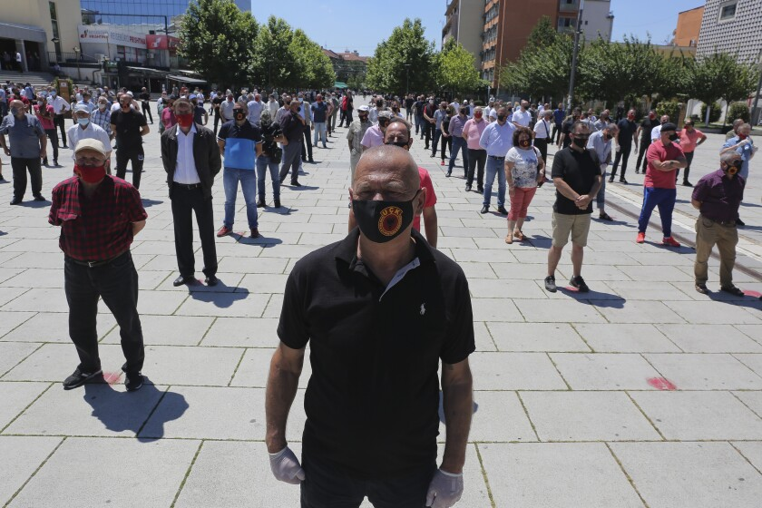 War veterans of the Kosovo Liberation Army (KLA) attend a protest in Pristina, Kosovo, Thursday, July 9, 2020. War veterans of the Kosovo Liberation army, or KLA, that fought for independence from Serbia held a protest against the indictment of the country's president being investigated of war crimes allegedly committed during and after a 1998-1999-armed conflict. (AP Photo/Visar Kryeziu)