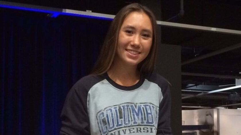 At a Nov. 9 ceremony inside the CIF San Diego Section Hall of Champions, San Dieguito Academy tennis star Jennifer Kerr signs her National Letter of Intent to play for Columbia University.