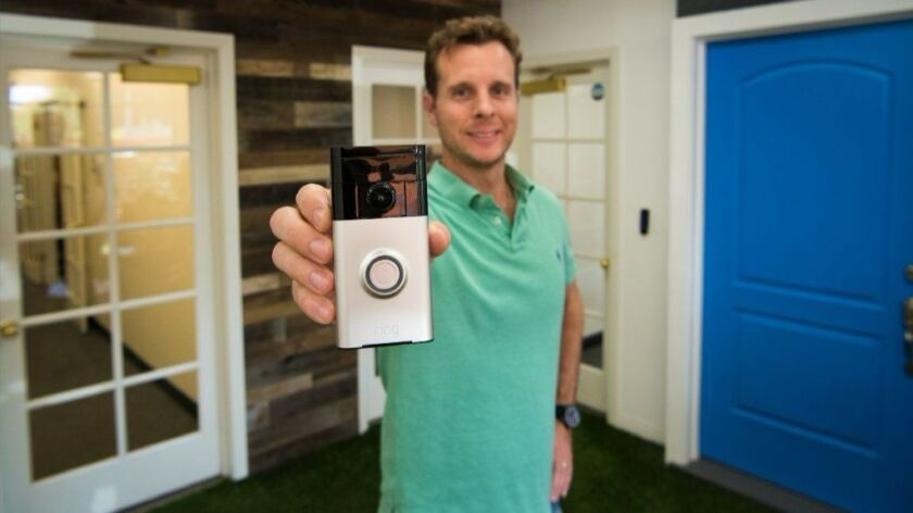 Ring founder and Chief Executive Jamie Siminoff holds a Ring video doorbell in the lobby of Ring's Santa Monica office.