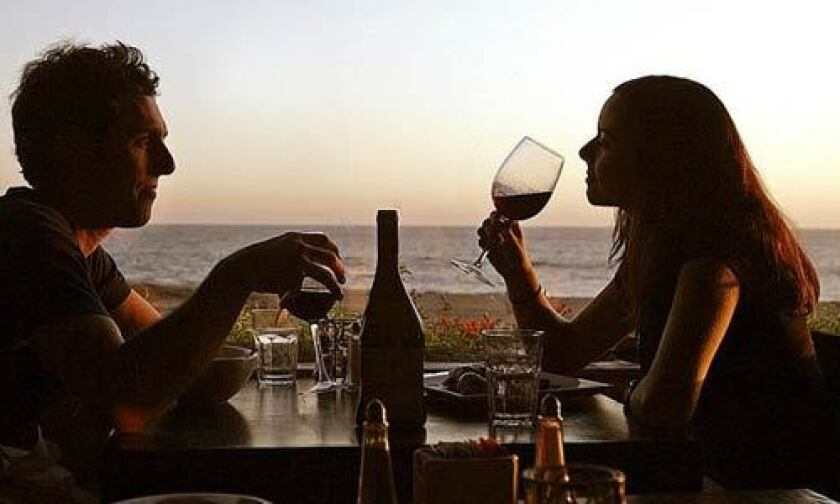 Diners enjoy views of the sea and sand from their table at the Sunset Restaurant in Malibu.