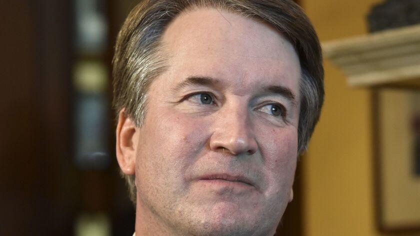 Supreme Court nominee Brett Kavanaugh visits GOP senators at the Capitol in July.