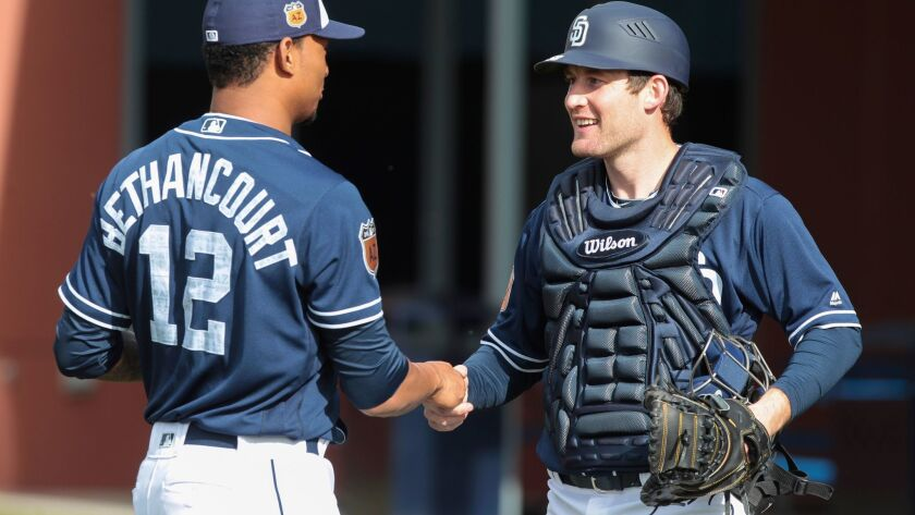 PEORIA , February 17, 2017 | Padres catcher Christian Bethancourt, left, shakes hands with fellow ca